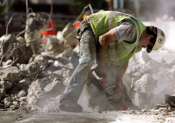 DES PLAINES, IL - OCTOBER 06: A worker cuts concrete along a road construction site October 6, 2006 in Des Plaines, Illinois. The U.S. Department of Labor's monthly employment report released today shows a dip in both job growth and the unemployment rate in September. (Photo by Tim Boyle/Getty Images)